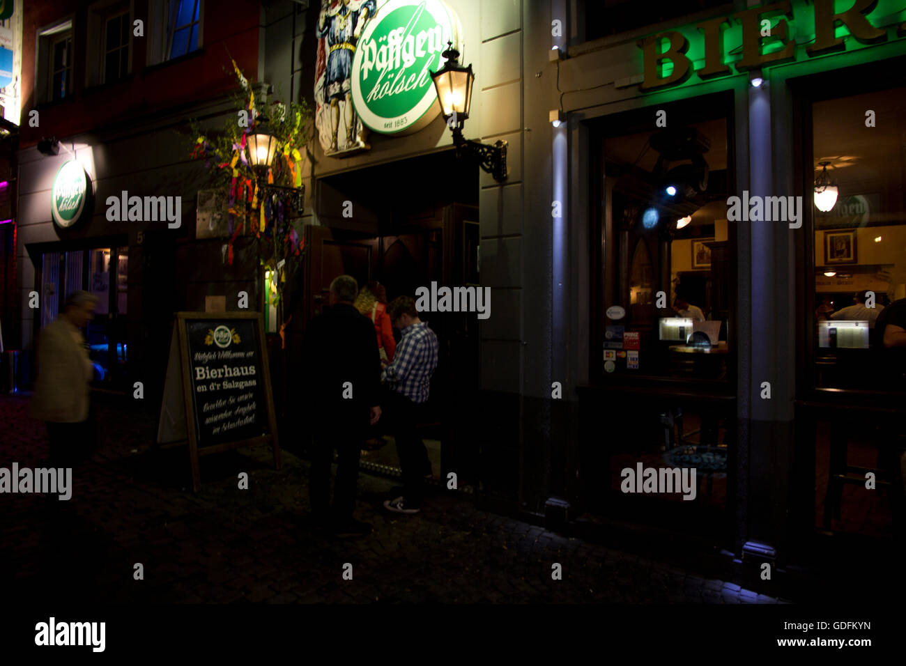 Paffgen Kolsch is one of Old Town Cologne's favorite brew houses serving Kolsch, a light, crisp beer brewed - Stock Image