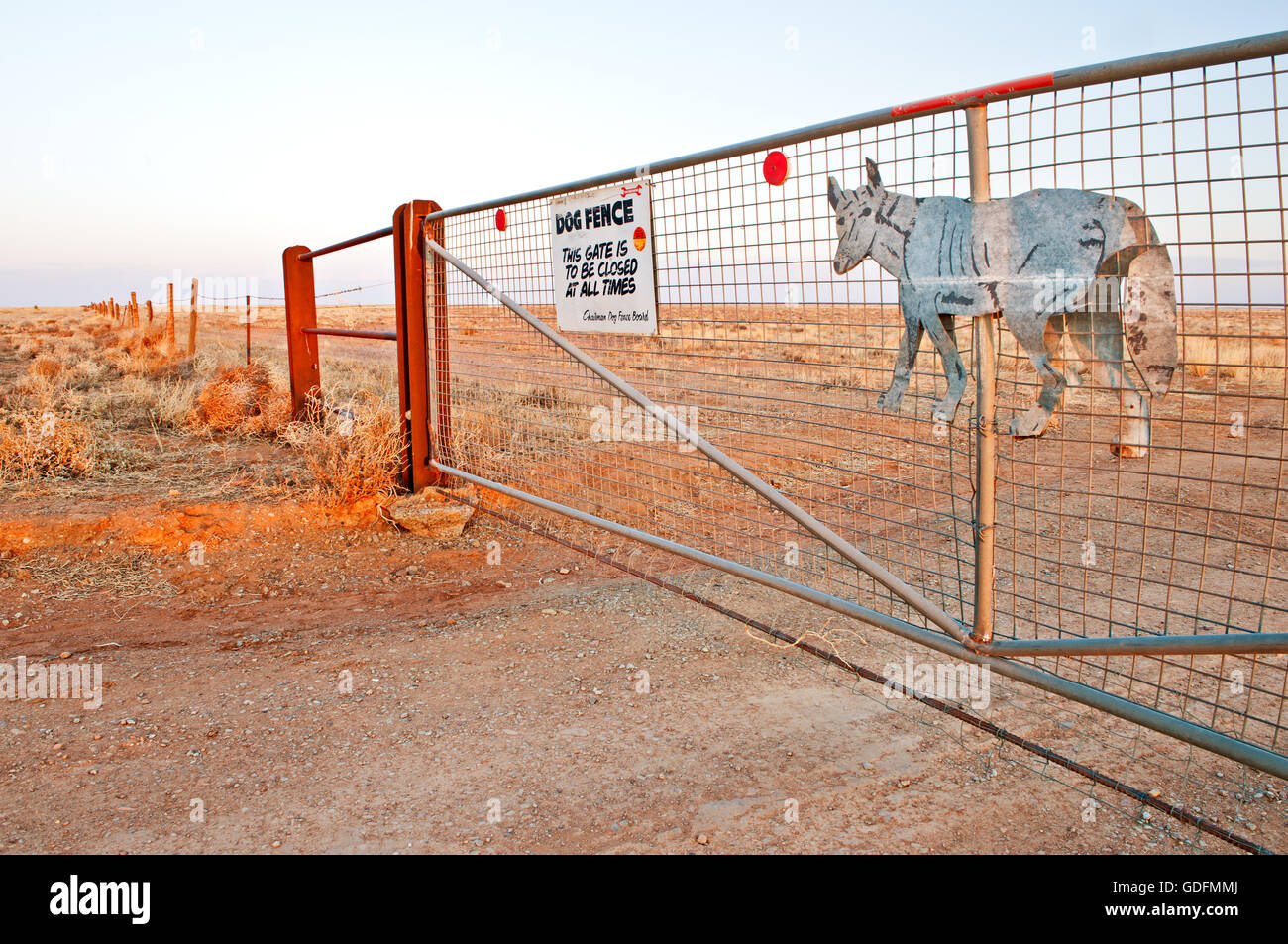 Gate of the Dingo Fence in the desert of South Australia. - Stock Image
