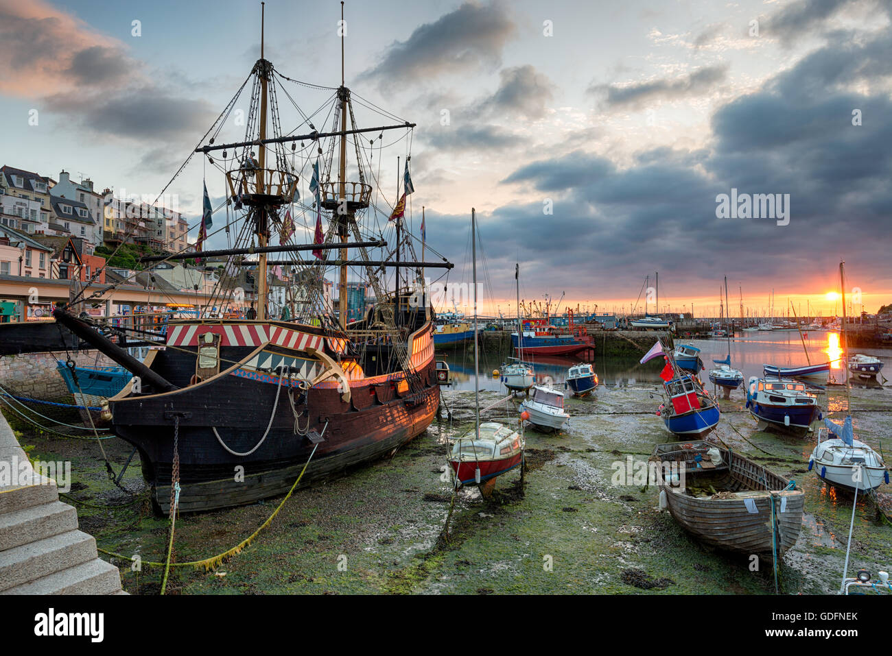 Stunning sunrise over a galleon in Brixham harbour on the south coast of Devon - Stock Image