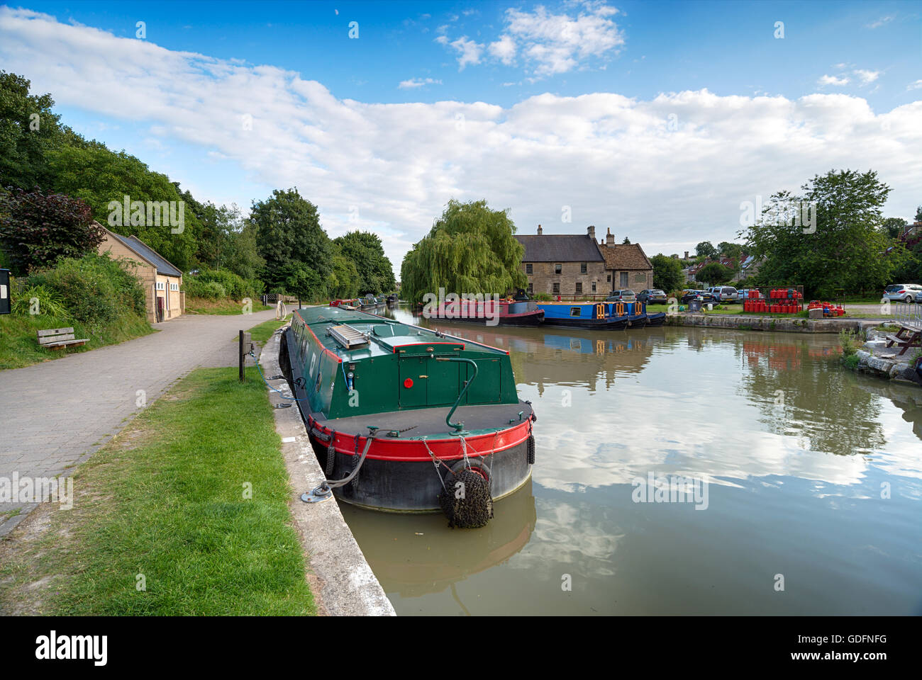 House boats moored on the Kennet & Avon Canal at Bradford on Avon in Wiltshire Stock Photo