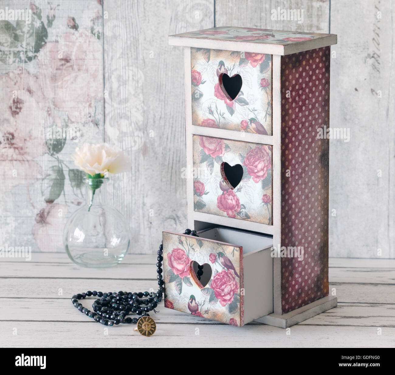 A shabby chic mini chest of drawers decoupaged in a vintage floral pattern - Stock Image