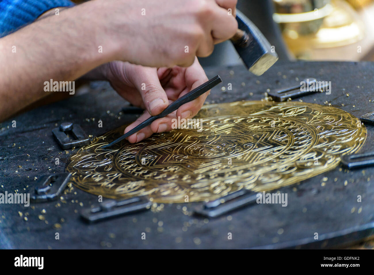 Two Hands of Craftsman Engraving Brass Plate Masterpiece - Stock Image
