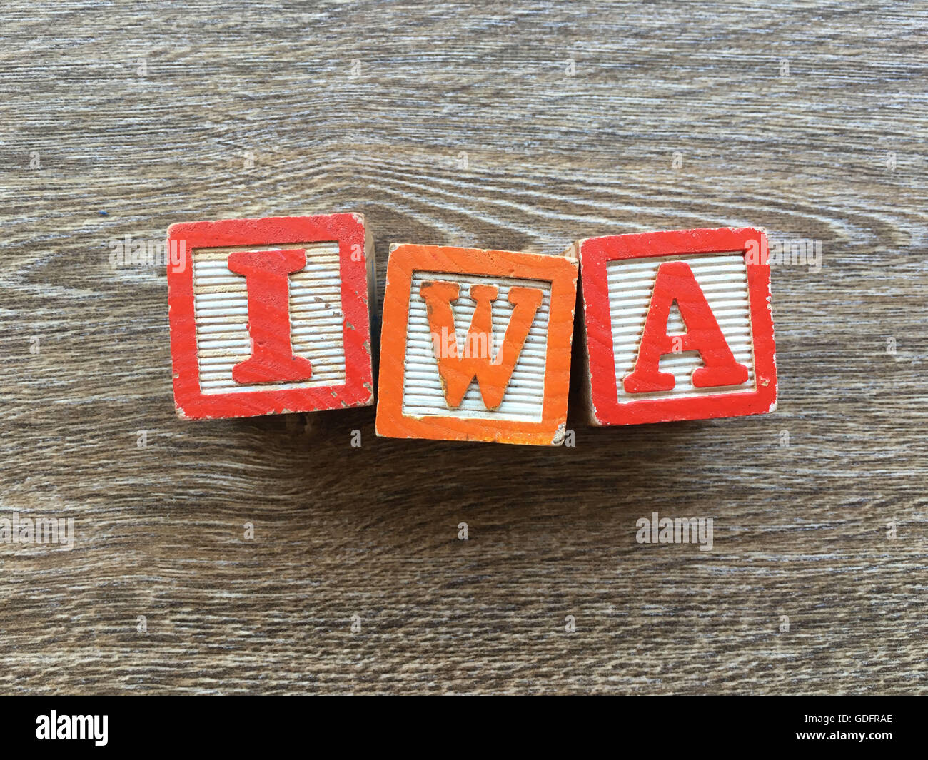 Iwa name written with wood block letter toys - Stock Image