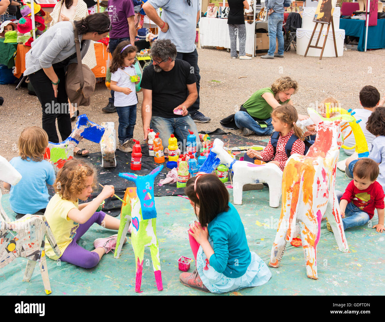 Children are entertained with arts and crafts at Rome's Testaccio Market. - Stock Image