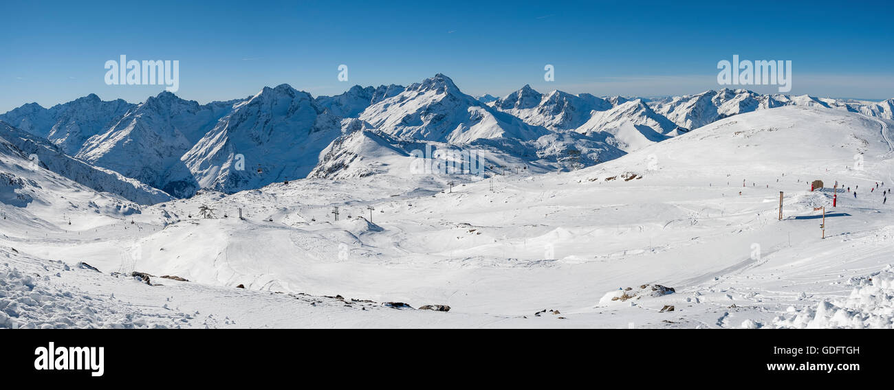 Snowy peaks, Pistes and ski lifts, ski resort 'Les Deux Alpes', Alps, France - Stock Image