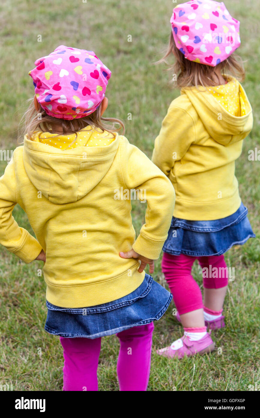 twins, girls at the same outfits - Stock Image