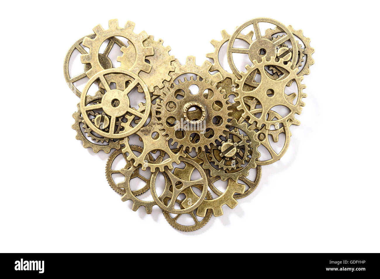 bronze gear heart on white, top view - Stock Image