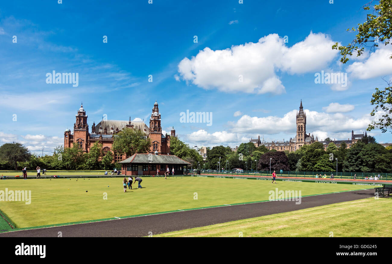 Kelvingrove Lawn Bowls and Tennis Centre with Kelvingrove Art Gallery and Museum left & The University of Glasgow - Stock Image