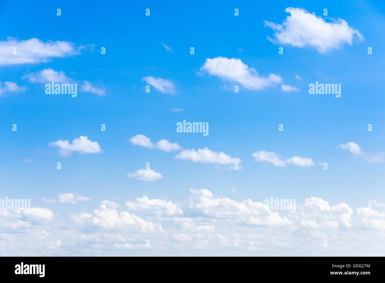 Clear blue sky with white fluffy clouds Stock Photo