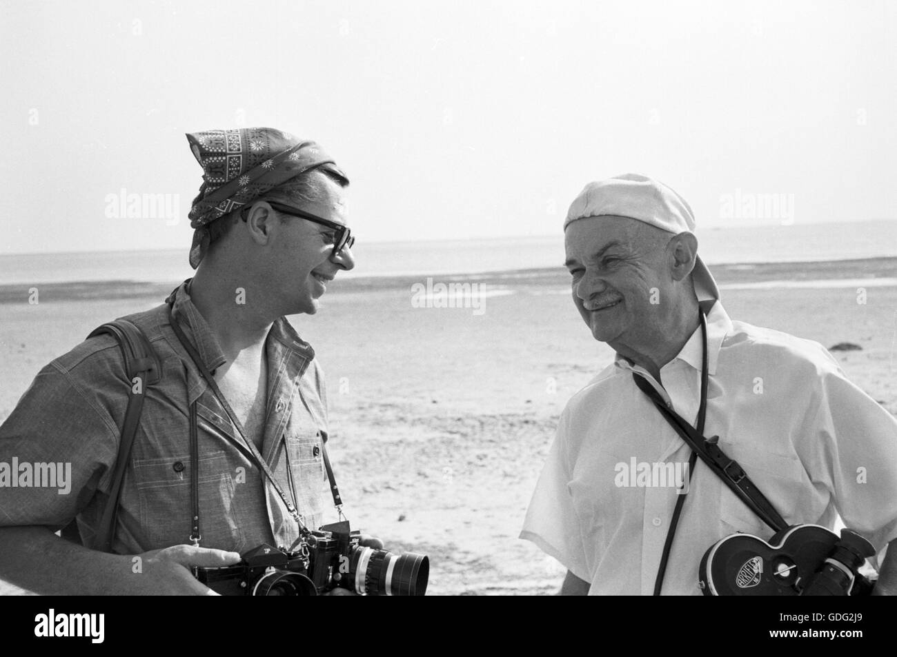 Phillip Harrington (left) and Roman Vishniac, collecting biological specimens - Stock Image