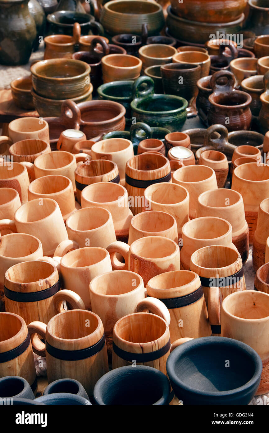 Wooden dishes, mugs and pitchers - Stock Image