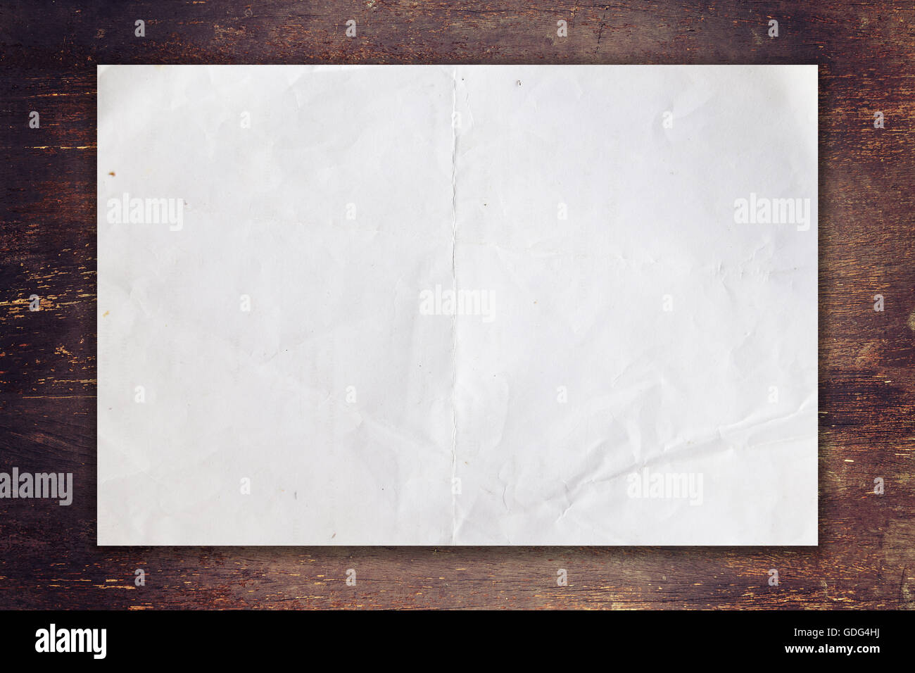 old paper on wood background with space - Stock Image