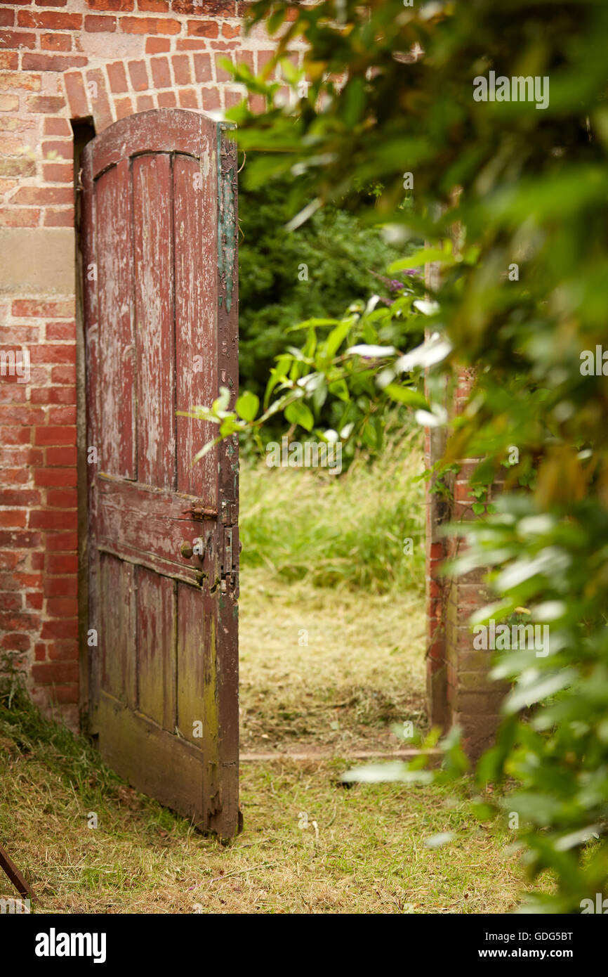 open old distressed walled garden gate - Stock Image