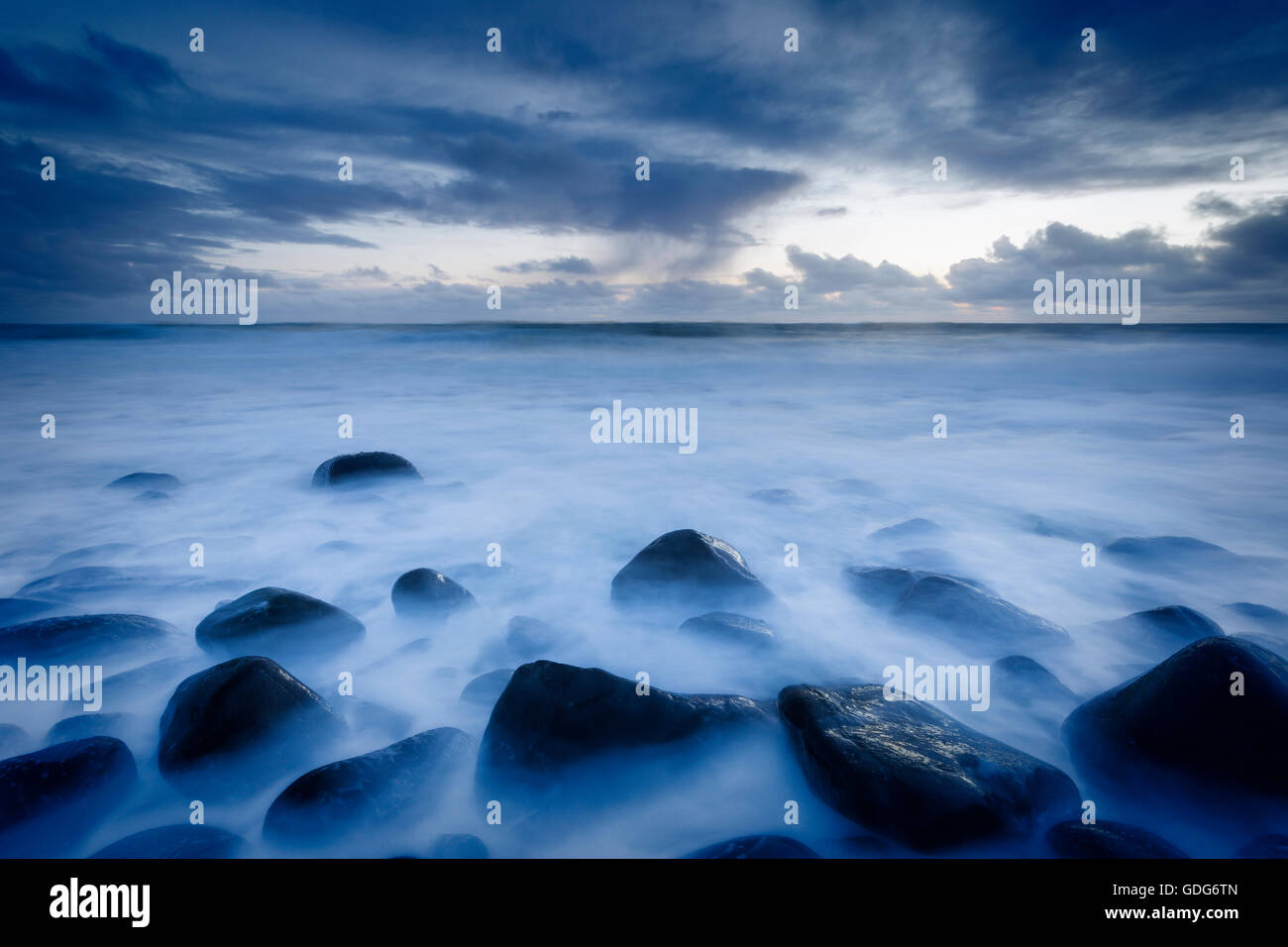 Death rocks during the blue hour at Embleton Bay - Stock Image