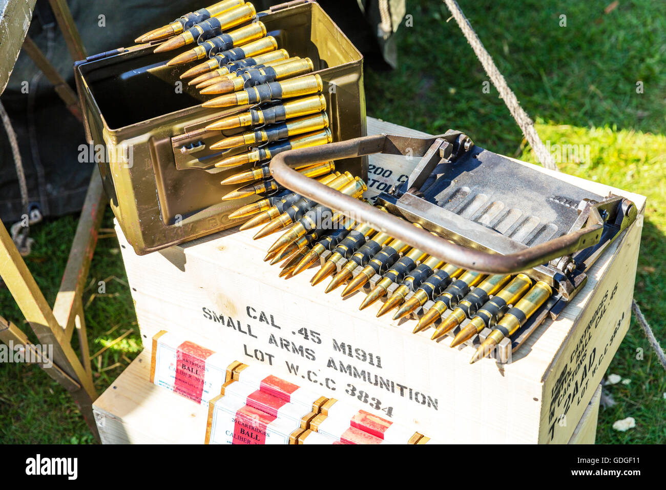 Bullets ammunition .45 cal caliber small arms ammunition boxes for war killing people devastation of lives murder - Stock Image
