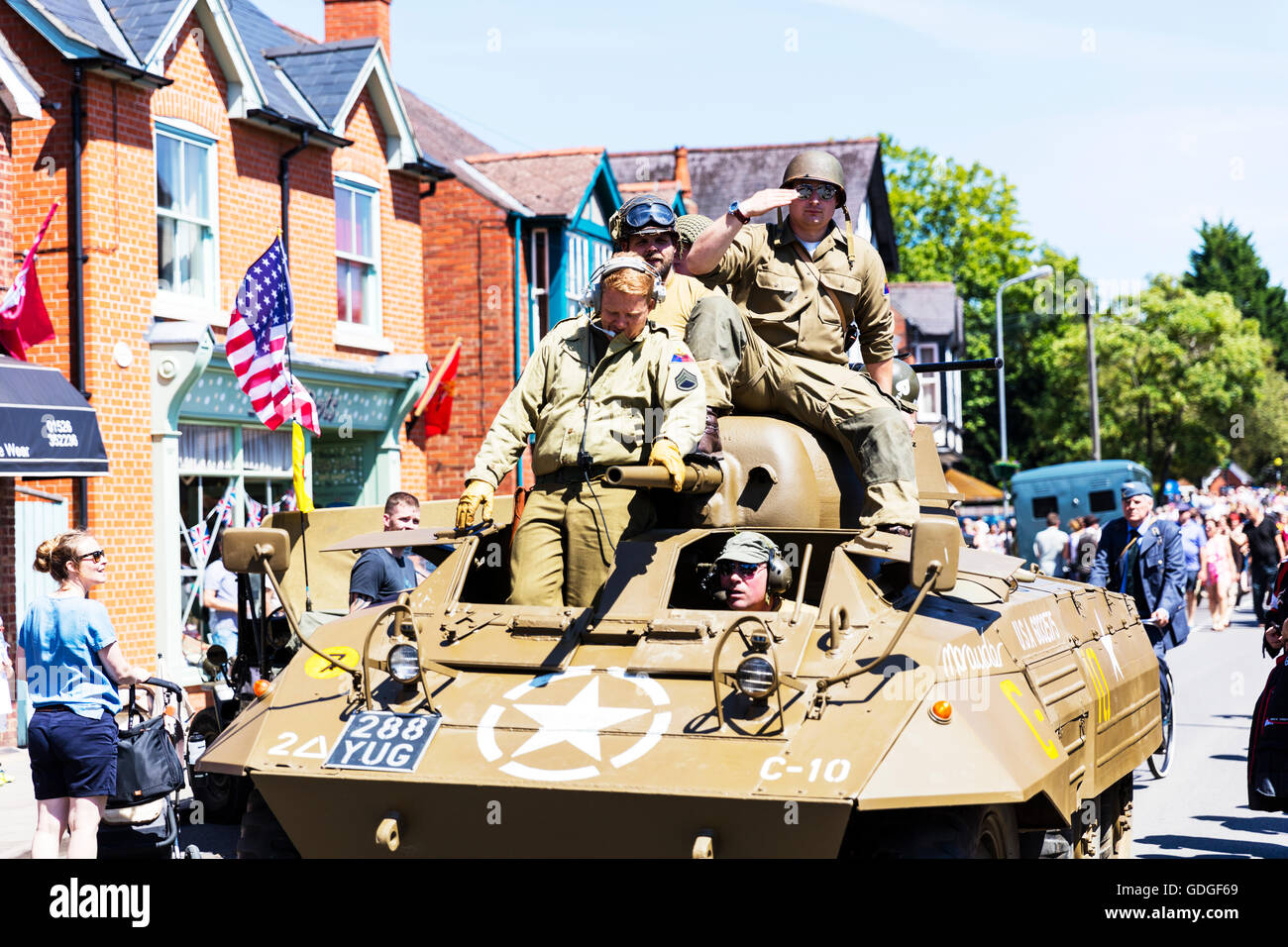 USA US army tank patrol on streets military forces returning from duty 1940's weekend People and vehicles from - Stock Image