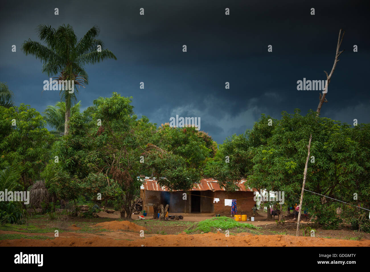 Yongoro, Sierra Leone - June 02, 2013: West Africa, the village of Yongoro in front of Freetown, rainstorm - Stock Image