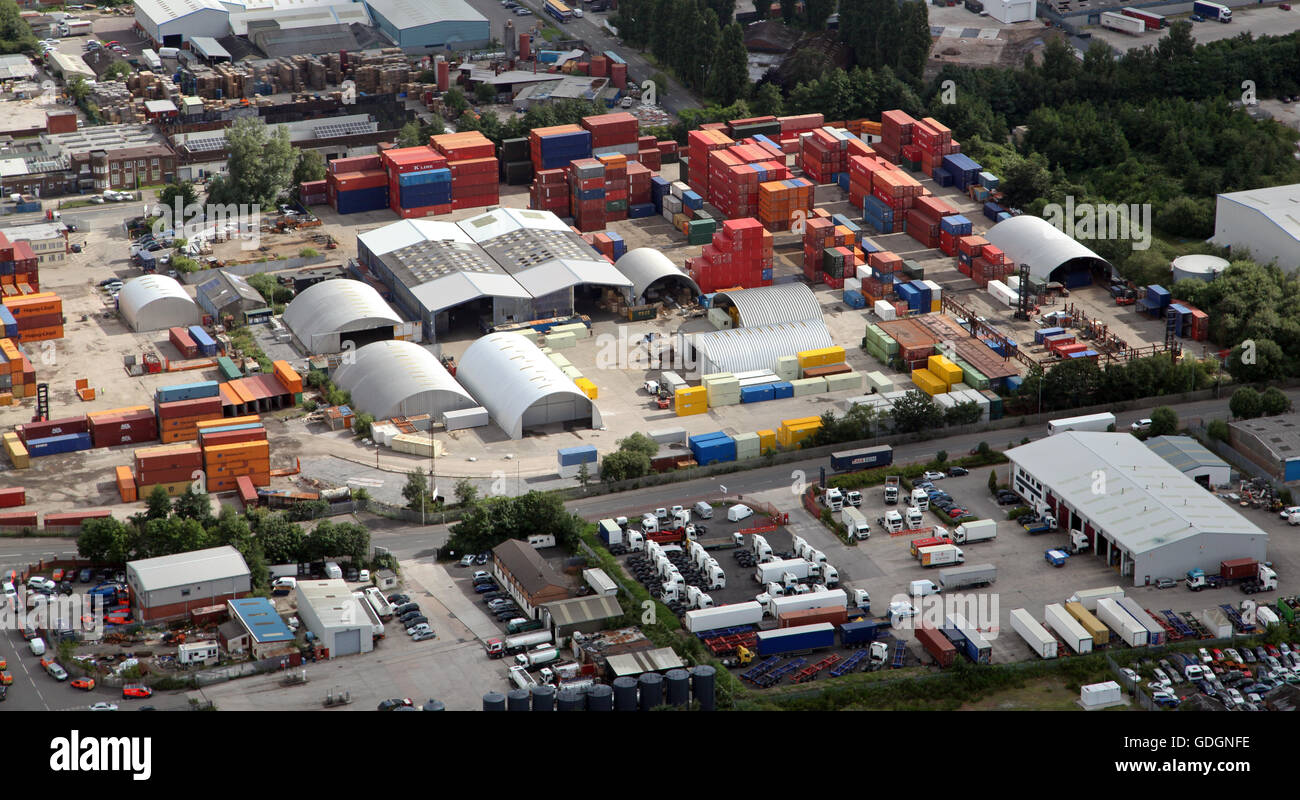 aerial view of colourful containers in a compound yard storage depot on an industrial estate, UK - Stock Image