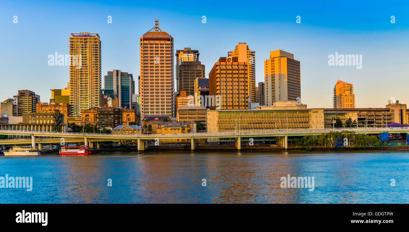 View of Brisbane from Southbank with the buildings shimmering off the Brisbane River - Stock Image