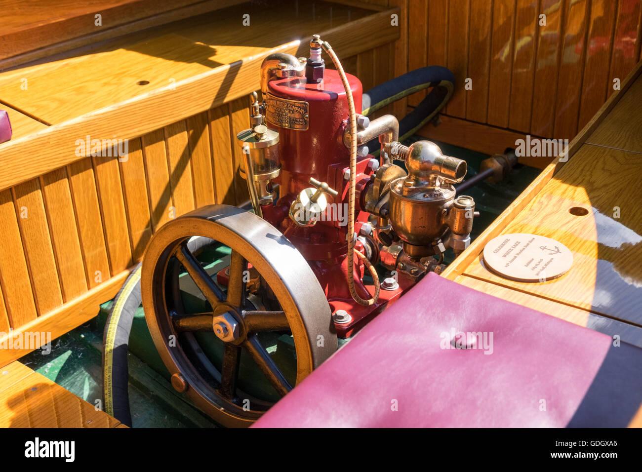 Cushman Motor Company marine engine mounted in an antique
