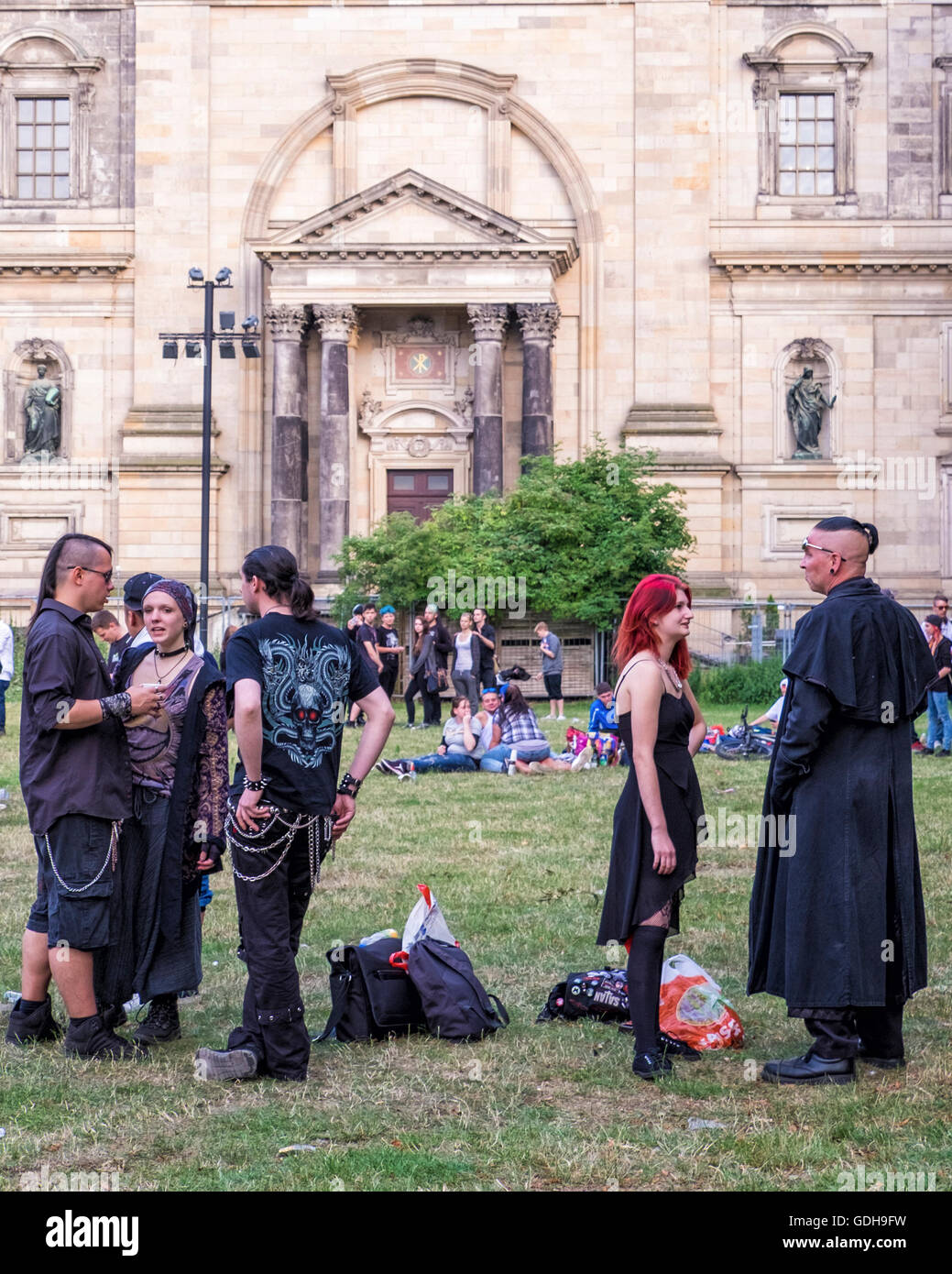 Berlin. Goths, Punks, rockers meet on grass next to the Berliner Dom. People in Alternate clothes, clothing hair, - Stock Image