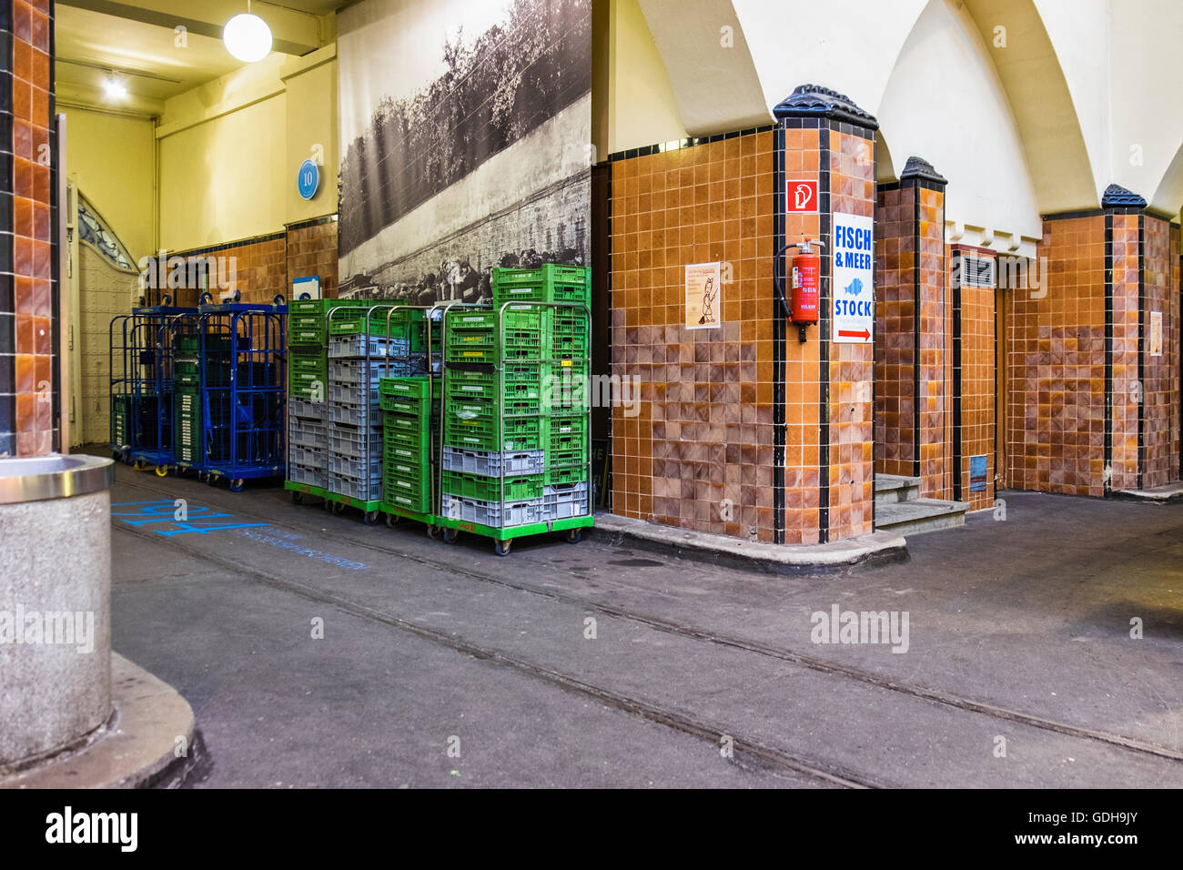Germany, Stuttgart, Markthalle. Old market hall interior with decorative tiles and old monochrome photograph - Stock Image