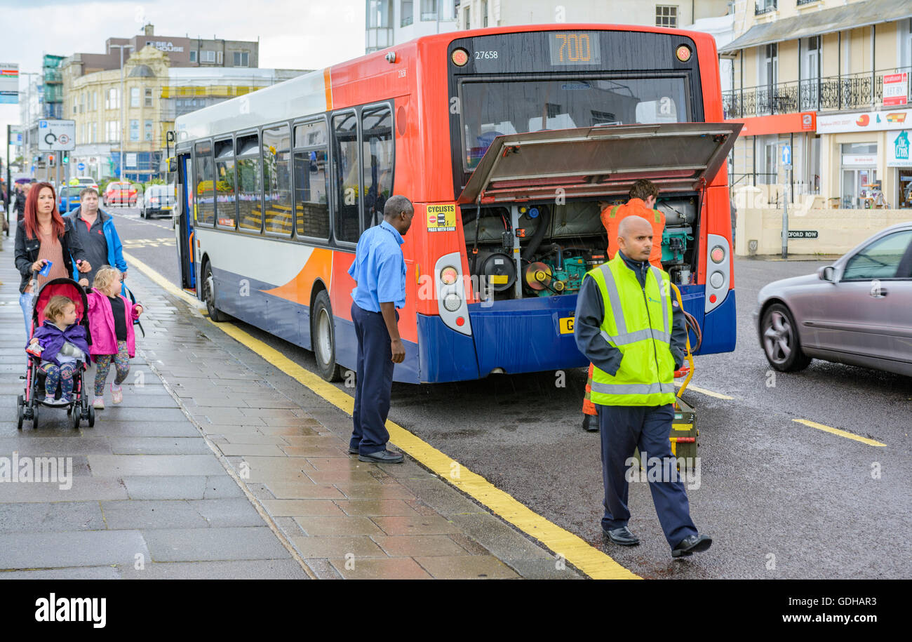 Broken down Stagecoach bus being fixed by a mechanic. - Stock Image