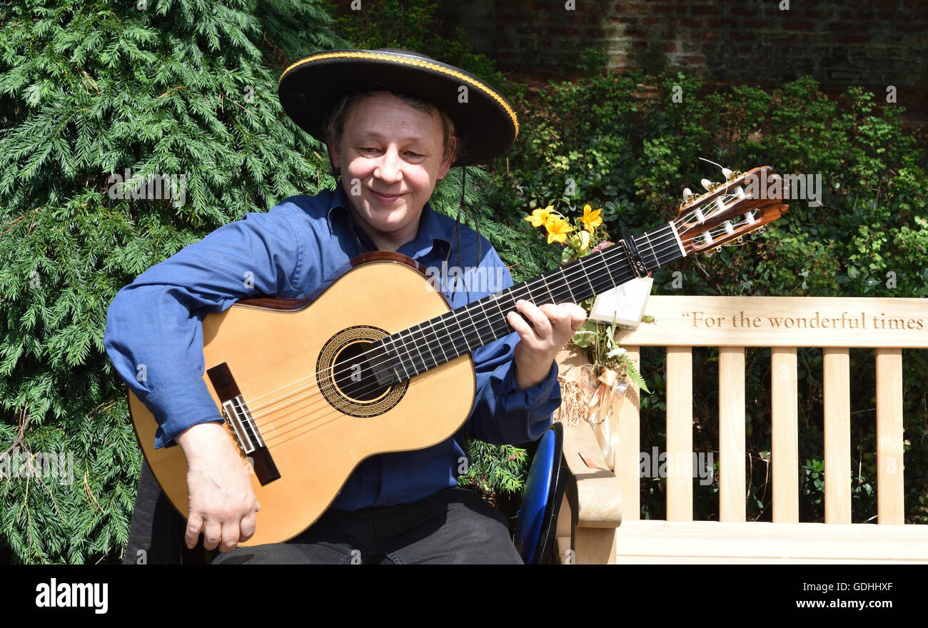 Manc hester, UK. , . An amateur musician plays at the 8th Annual Didsbury Guitar Trail in Fletcher Moss Gardens, - Stock Image
