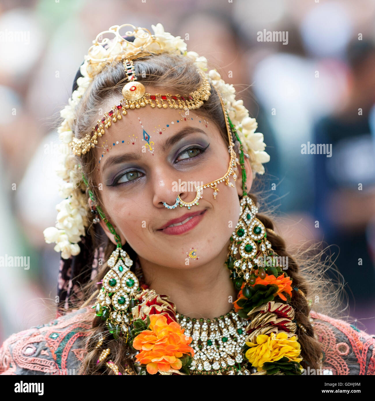 """London, UK. 17 July 2016.  A girl dressed as Lord Krishna's consort.  Devotees celebrate the annual Rathayatra festival (""""cart festival""""), in central London.  Hare Krishna followers towed three huge decorated carts from Hyde Park corner to Trafalgar Square, singing and dancing all the way. Credit:  Stephen Chung / Alamy Live News Stock Photo"""