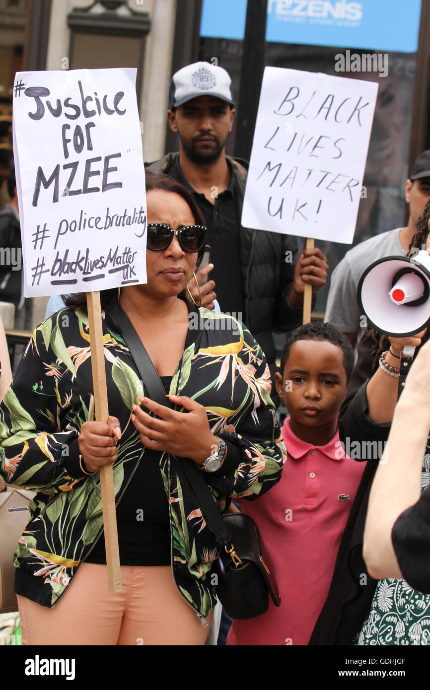 London, UK. 17th July, 2016: Ava Morgan a family friend of the Mzee Mohammed seen with her son ahead of the Black - Stock Image