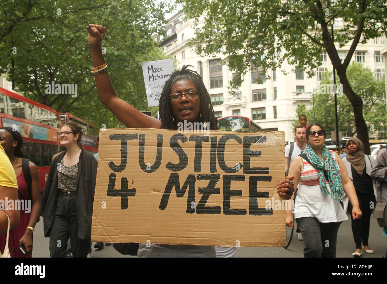 London, UK. 17th July, 2016: Marcia Riggs marches with her fist clenched during the Black Lives Matter march for - Stock Image