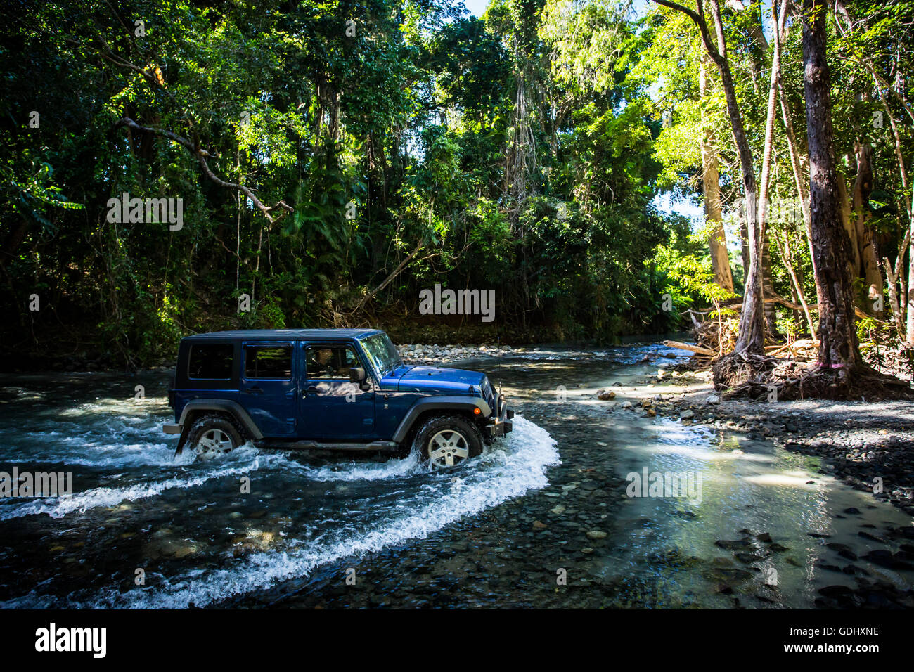 A 4WD only road across a river near Cape Tribulation in the Daintree, Queensland, Australia - Stock Image