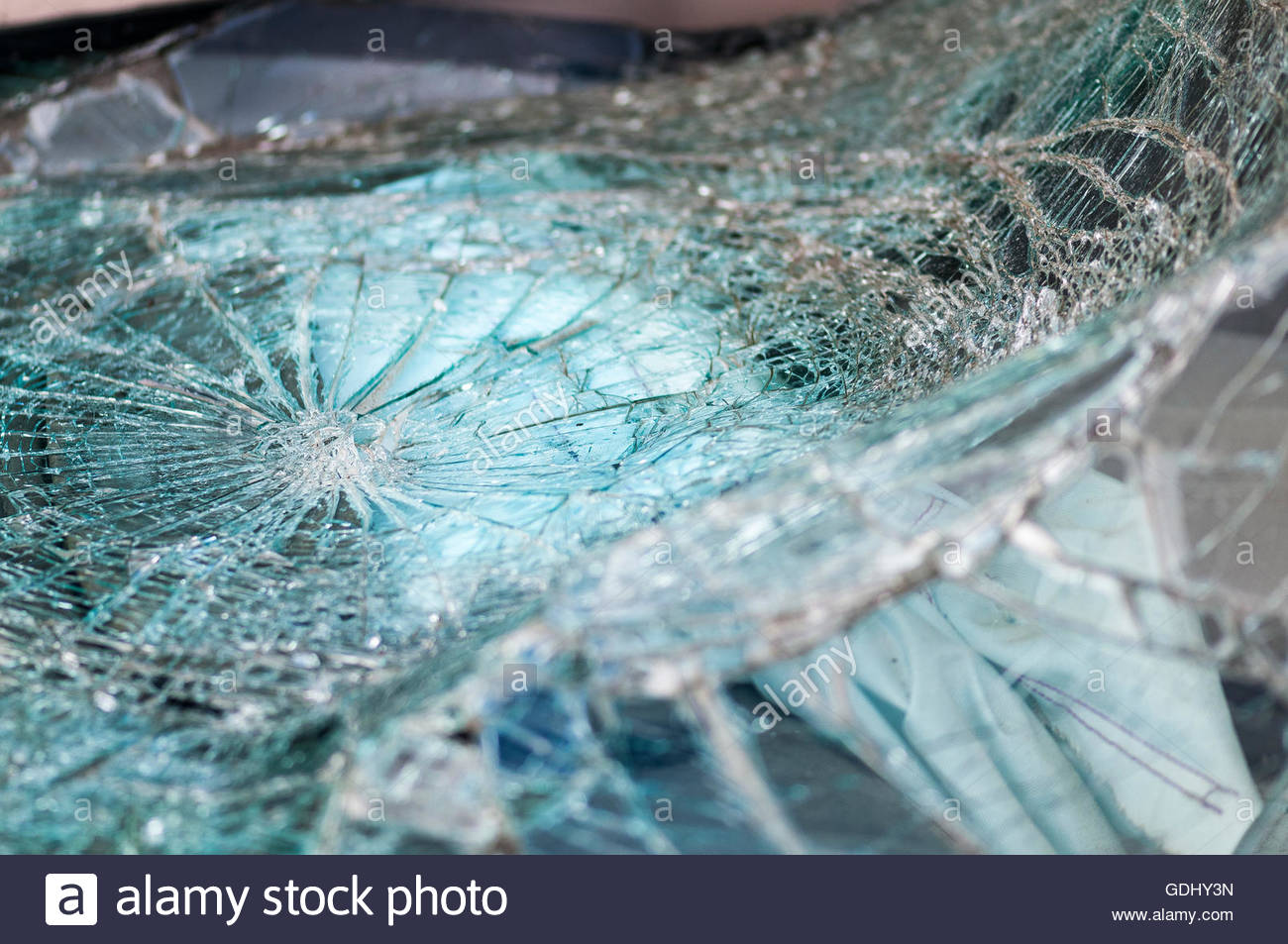 Automobile window warped into web of cracks from crash - Stock Image