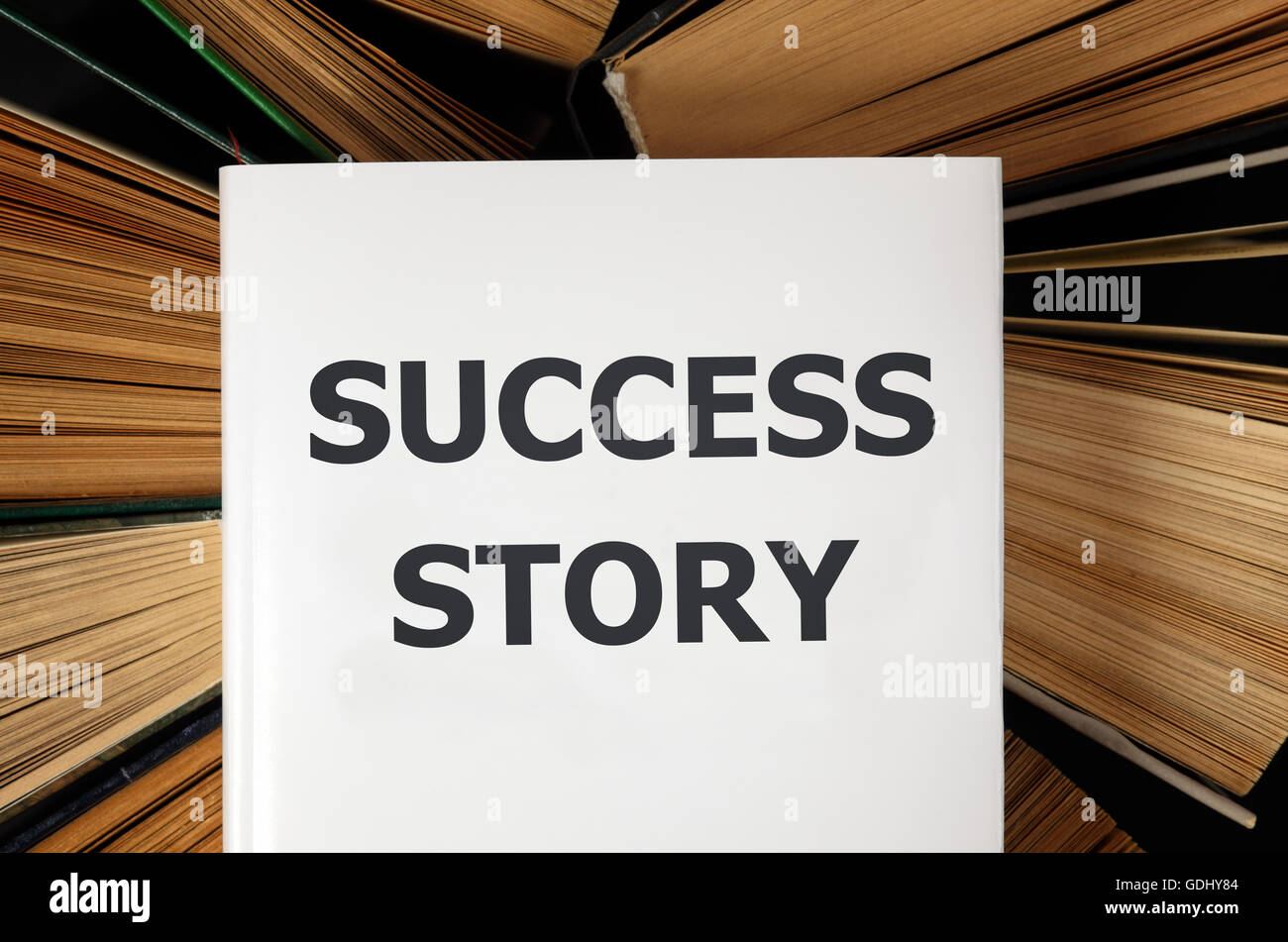 Top view of Success Story book  with old hardback books background - Stock Image