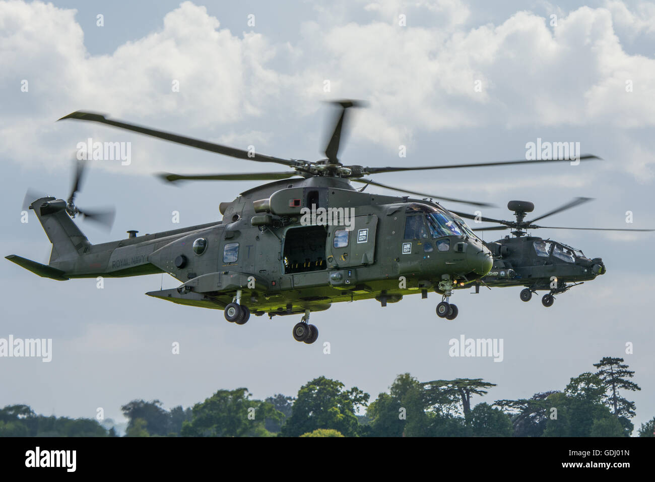 Agusta Westland Merlin HC3 with Apache AH1 in the background. - Stock Image