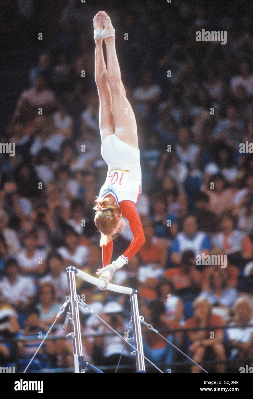Julianne McNamara performs in uneven bars competition at 1984 Olympic Games in Los Angeles. - Stock Image