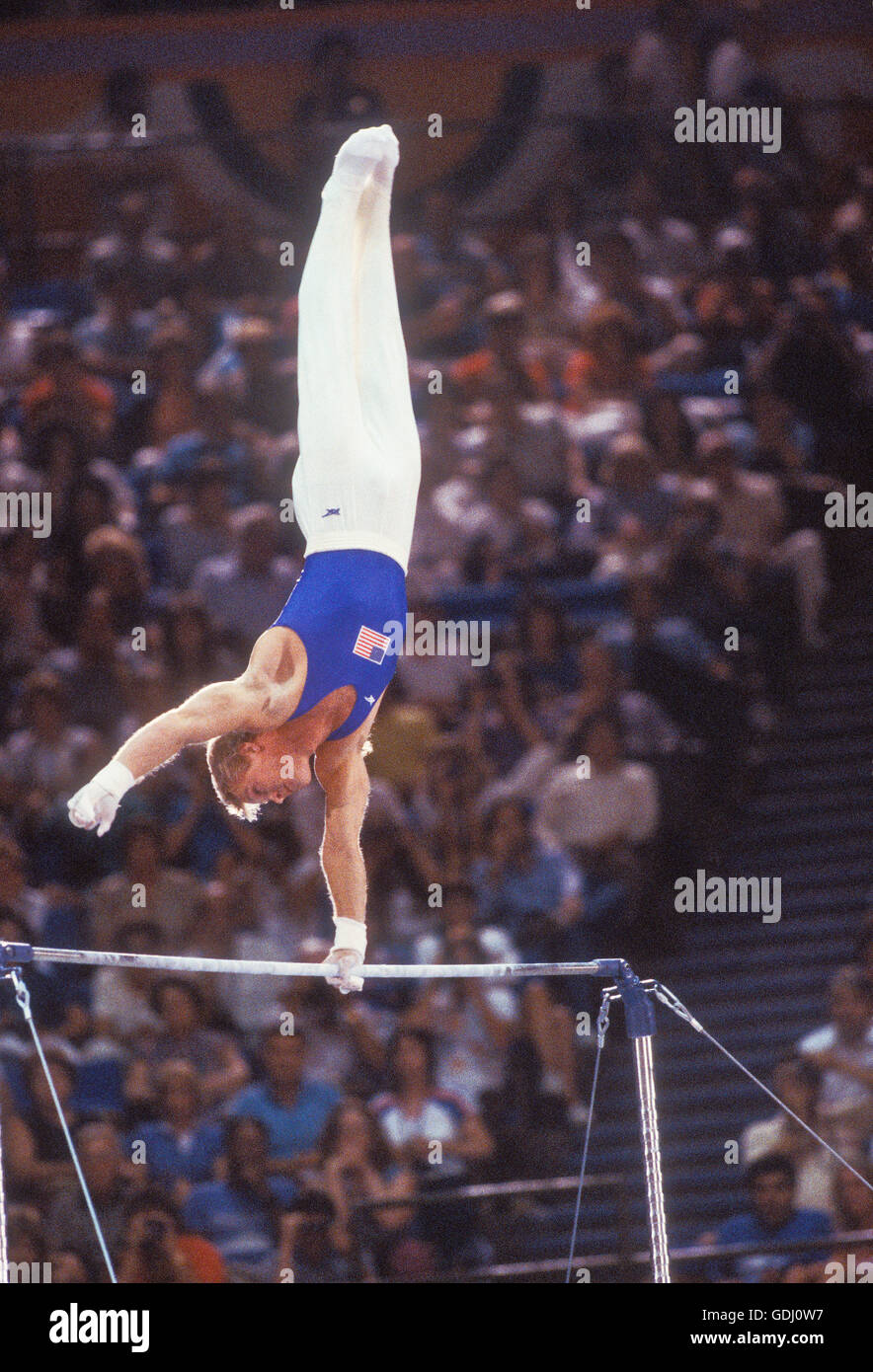 Bart Conner of USA performs on horizontal bar at 1984 Olympic Games in Los Angeles. - Stock Image