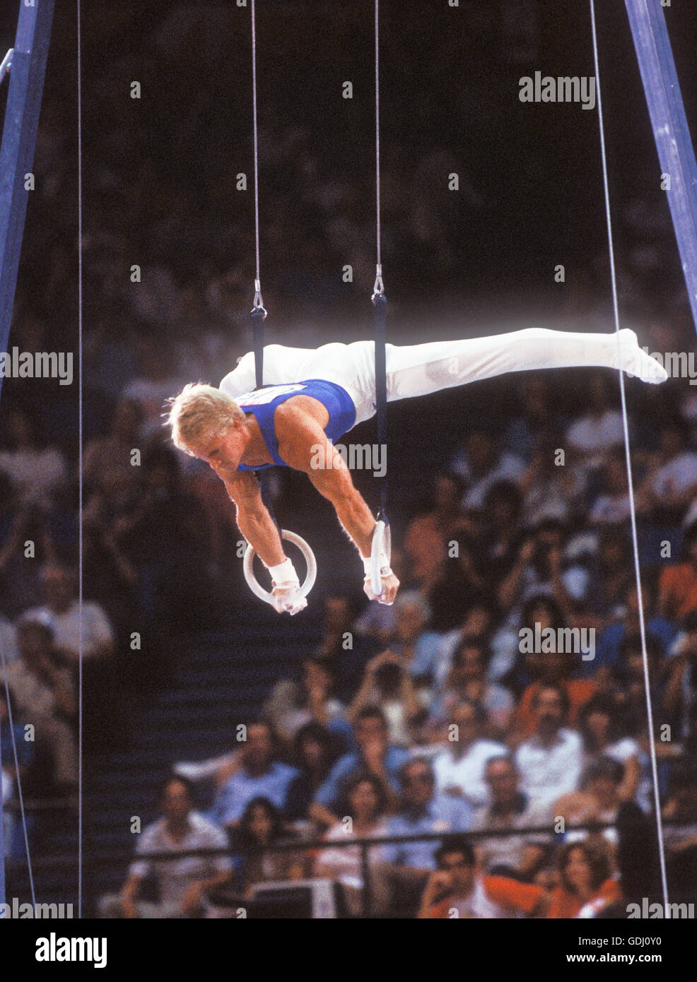 Bart Conner of USA performs on rings at 1984 Olympic Games in Los Angeles. - Stock Image