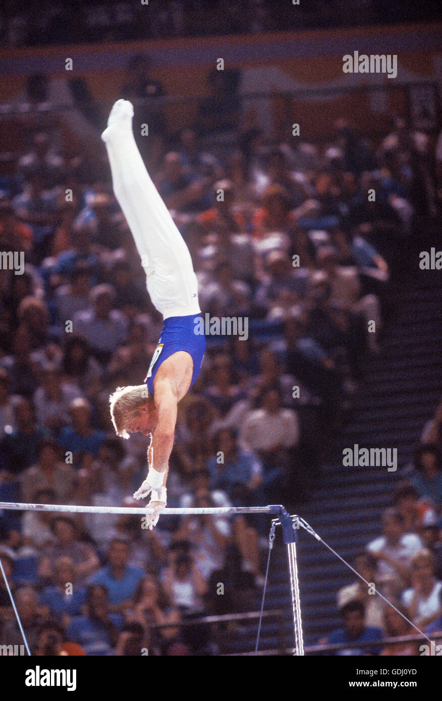 Bart Conner of USA performs on horizontal bar at 1984 Olympic Games in Los Angeles. Stock Photo