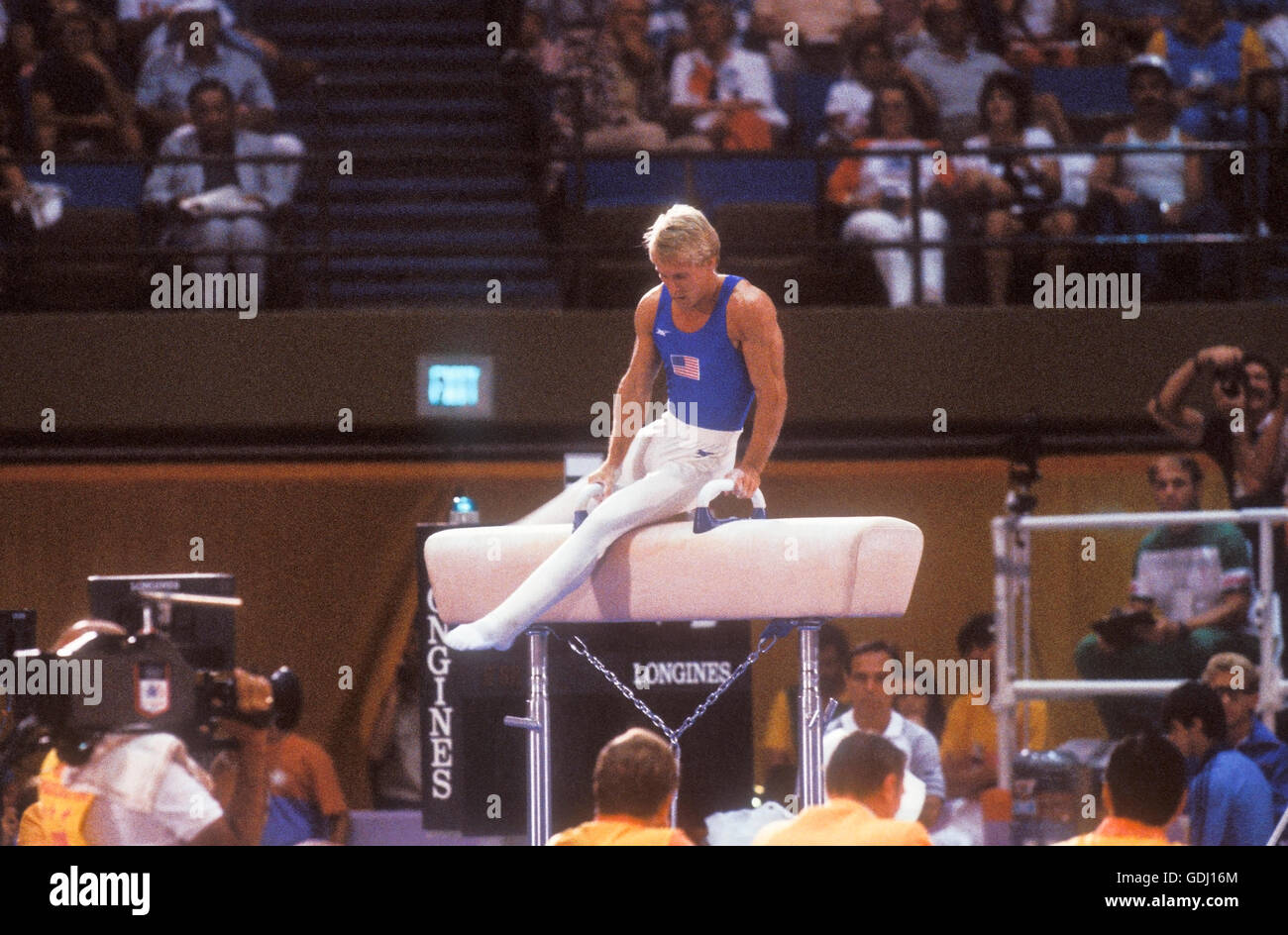Bart Conner of USA performs on pommel horse during gymnastics competition at 1984 Olympic Games in Los Angeles. - Stock Image