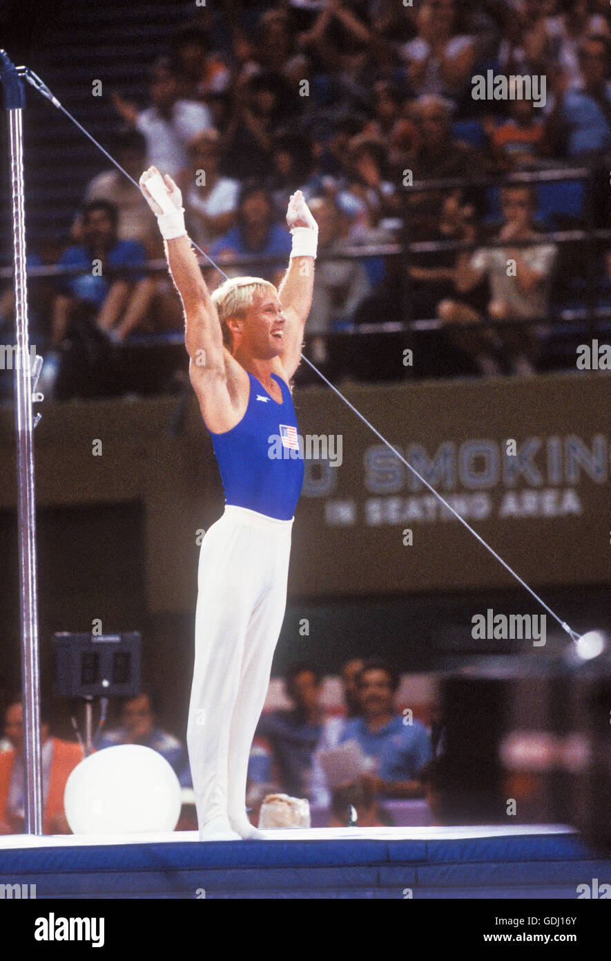 Bart Conner of USA receives applause from crowd during gymnastics competition at 1984 Olympic Games in Los Angeles. - Stock Image