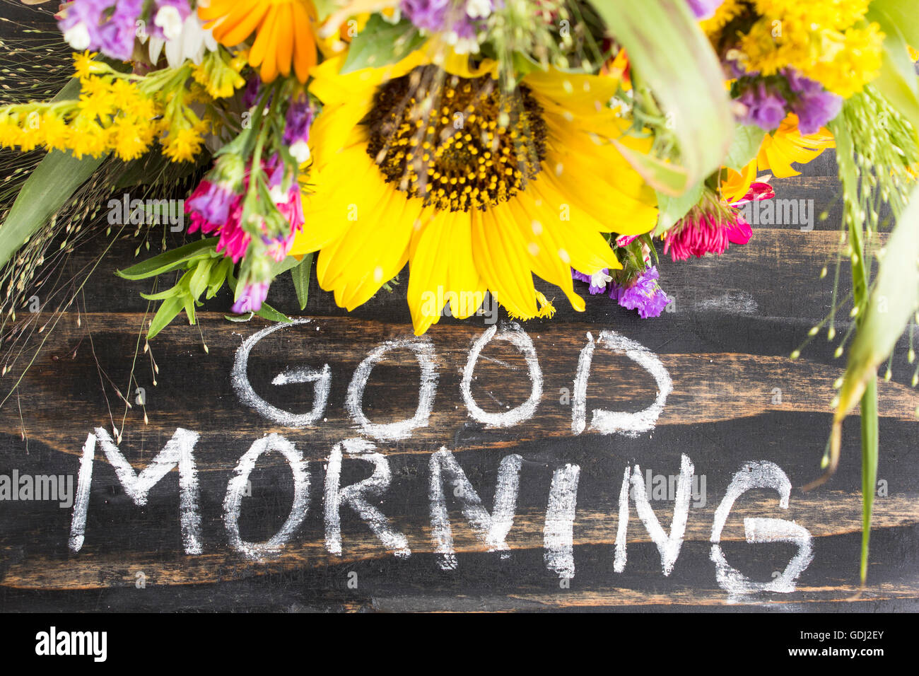 Words Good Morning With Summer Flowers On A Rustic Wooden Background