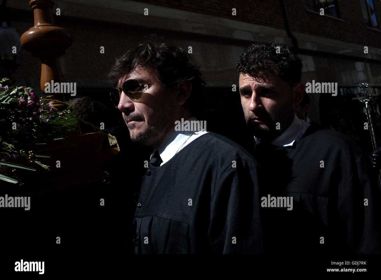 People carry a religious image during an Easter Holy Week procession in Astorga, Castilla y Leon, Spain. - Stock Image
