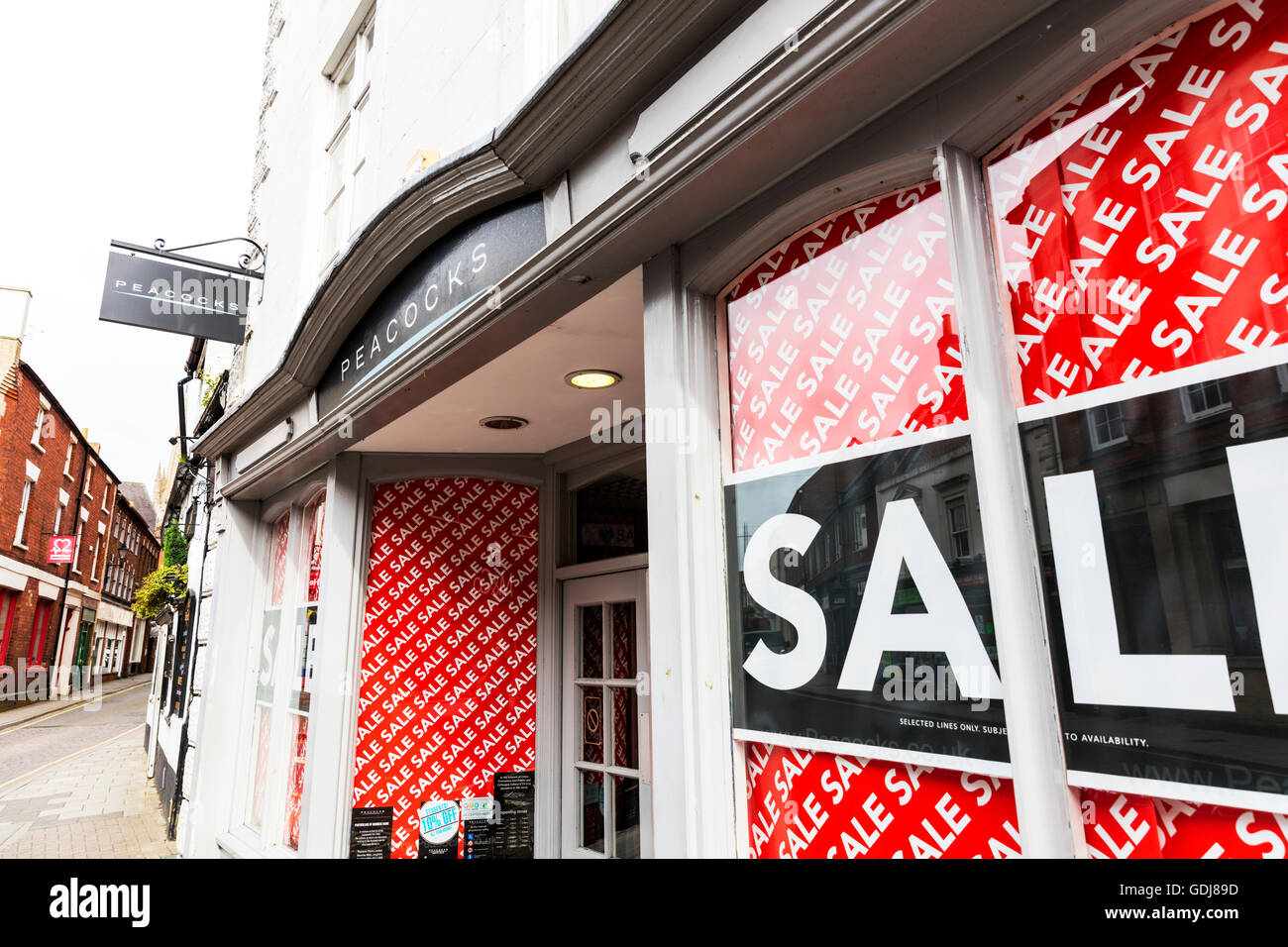 Peacocks clothing chain store shop shops sign sale sales high street clothes shop UK England building exterior front - Stock Image