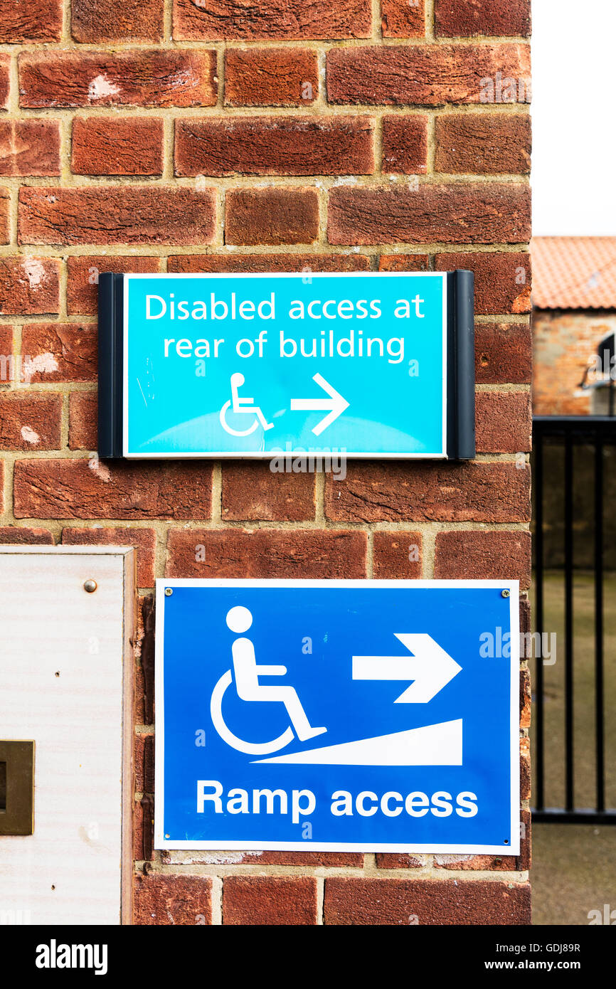 Disabled ramp access sign signs wheelchair ramps available UK England - Stock Image