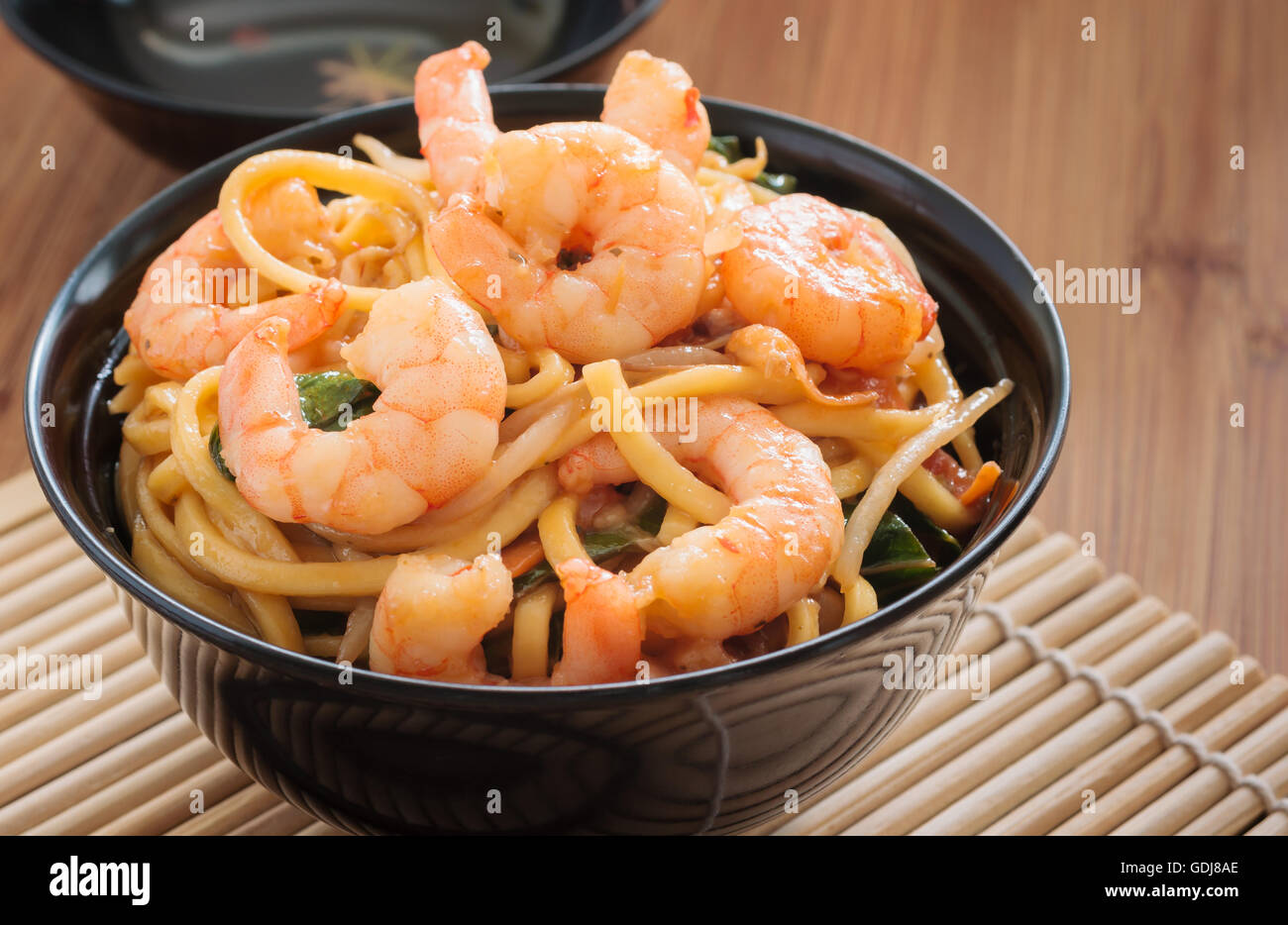 Prawn Chow Mein or Lo Mein stir fried prawns with egg noodles vegetables and bean sprouts - Stock Image