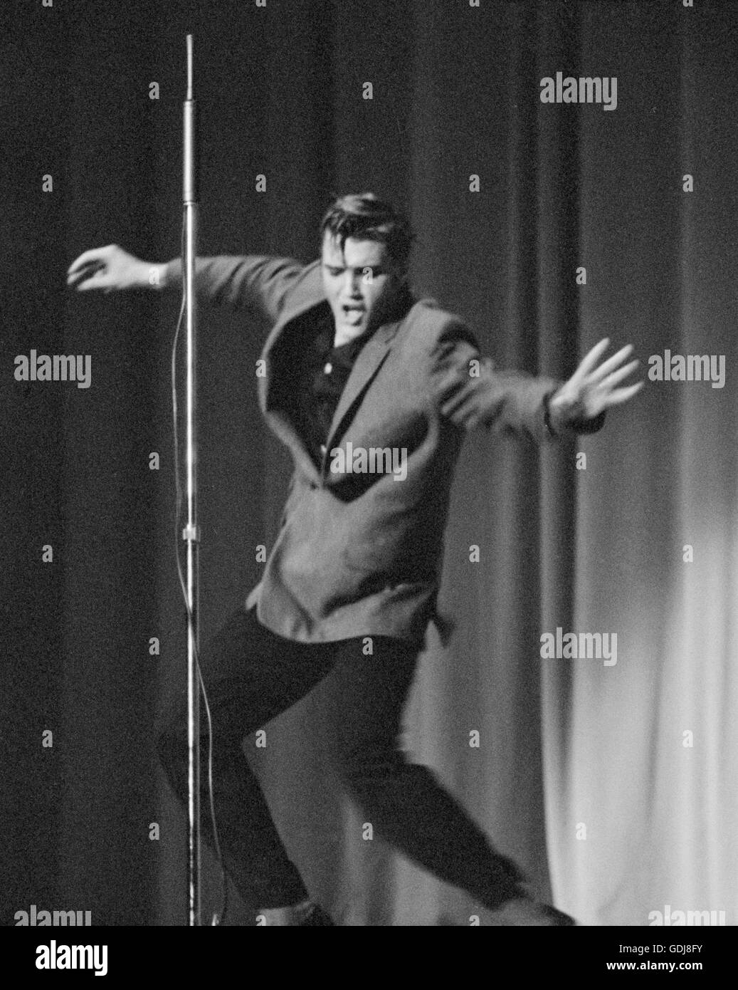 Elvis Presley, performing on stage, May 26, 1956. Stock Photo