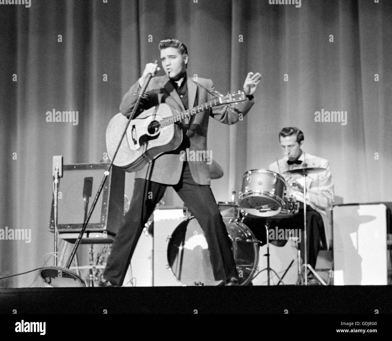 Elvis Presley, performing on stage, May 26, 1956. - Stock Image