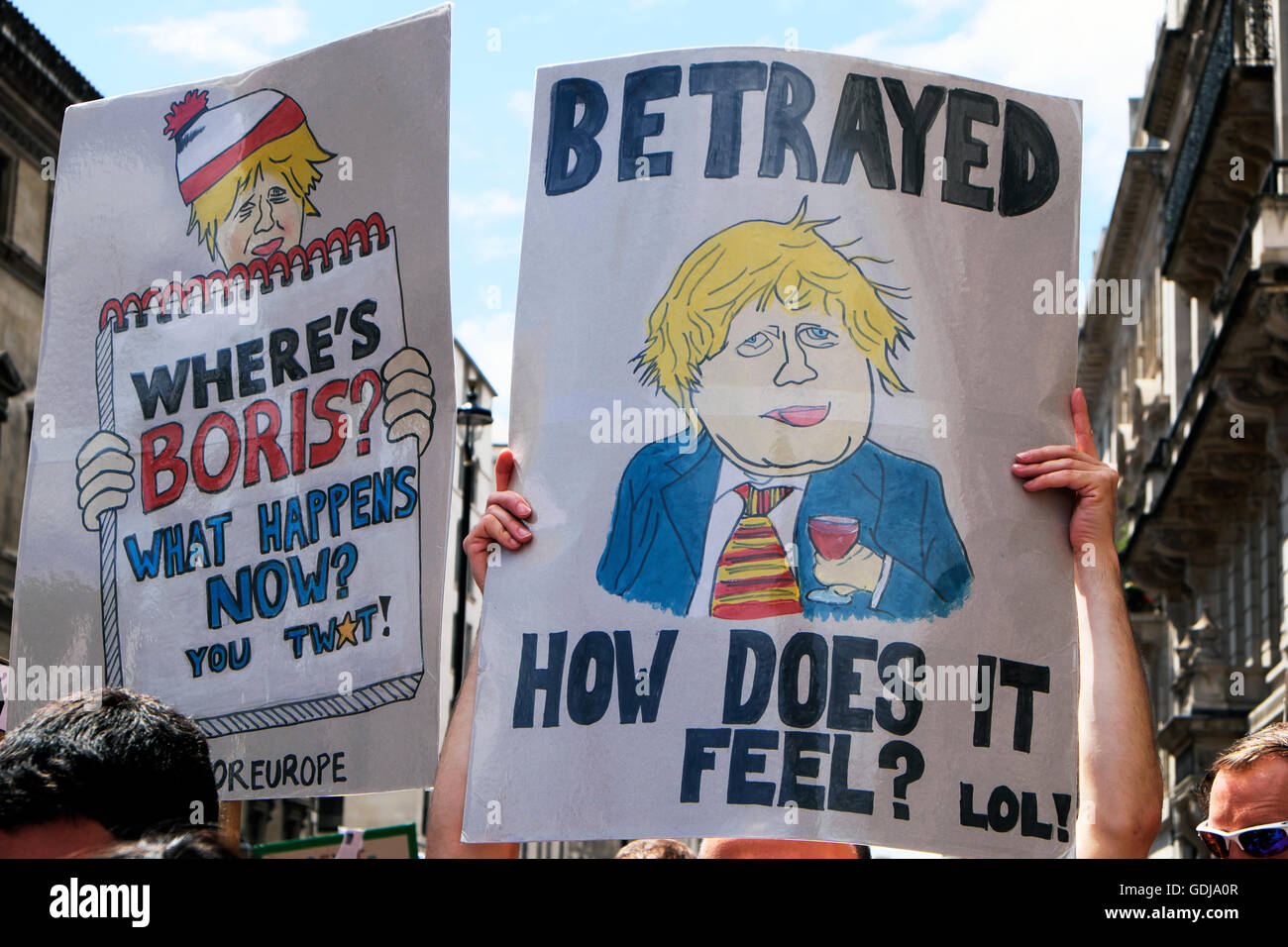 Protesters protestors holding anti Boris Johnson posters at Brexit referendum  'March for Europe'  demonstration - Stock Image