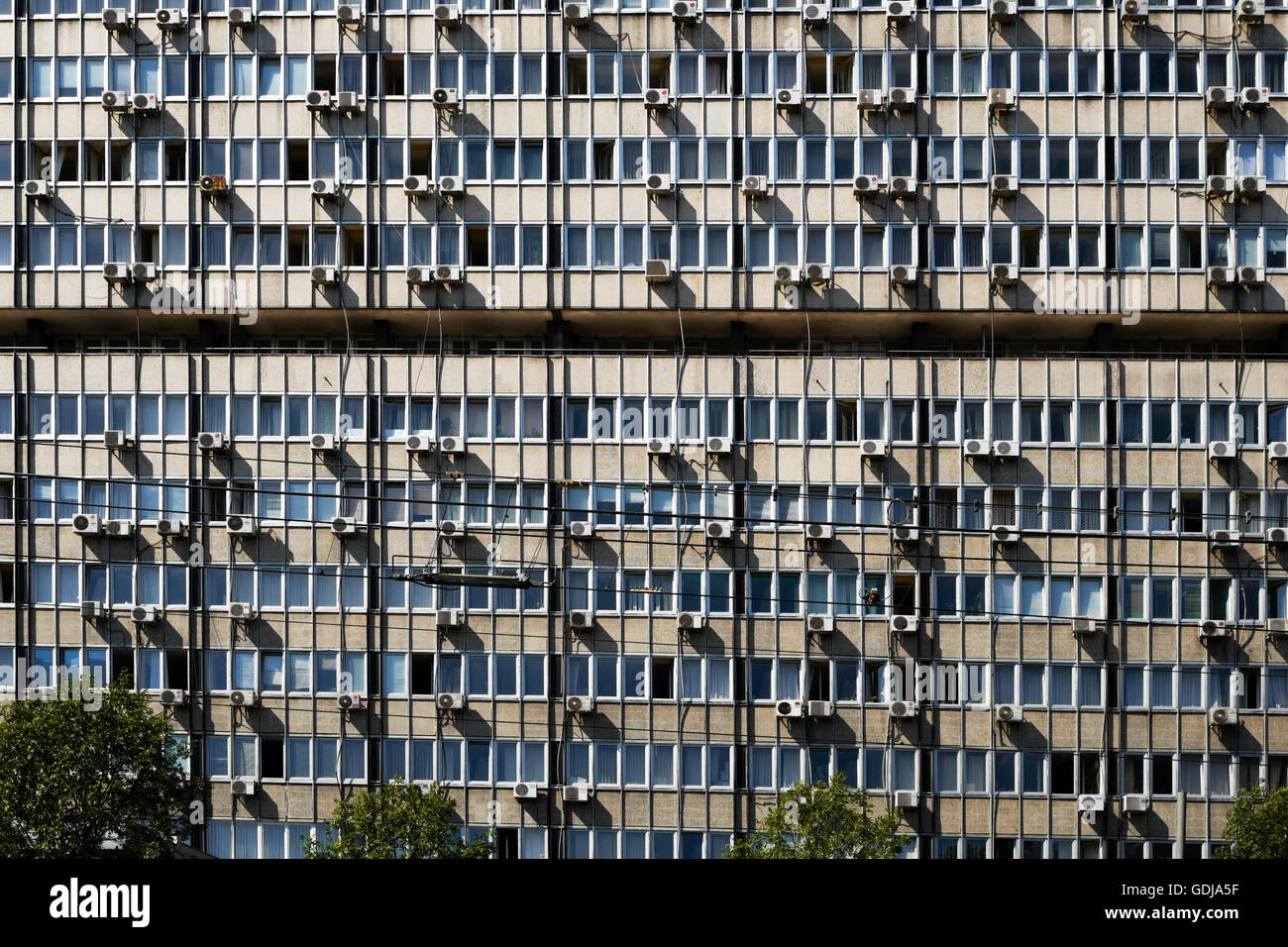 High rise public building exterior  with air conditioning units in Belgrade Serbia - Stock Image